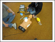 EMT students go through the steps of using an AED